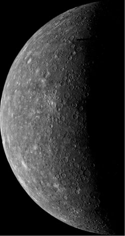 The planet Mercury, half in shadow.