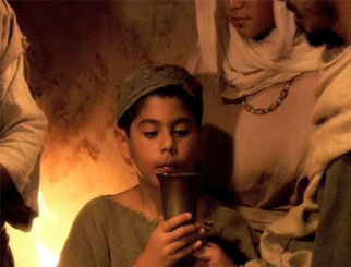 A reenactment of a child participating in Shabbat