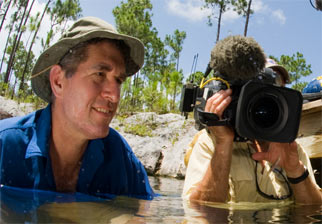 James Barrat in water with cameraman