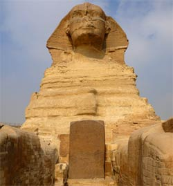 The Dream Stela stands at the base of the grand, but weathered, Sphinx