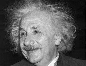 Einstein's smiling face in black and white.