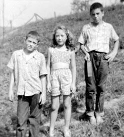 young Lonnie, left, in an early photo with his sister Regina and brother Roscoe