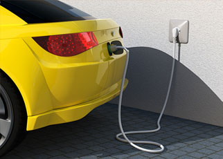 An electric car plugged in to an outlet