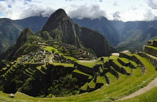Machu Picchu residential complex surrounded by green mountains.
