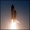 Space shuttle at liftoff