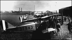 Early twentieth-century biplane on field (period photo)