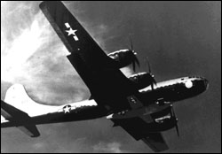 The B-29 in flight, with the X-1 slung beneath it.