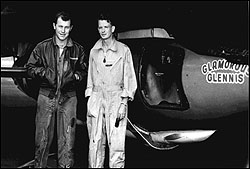 Yeager and Ridley, posing in front of X-1 as it's slung under parked B-29