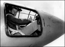 Yeager sitting in cockpit of the X-1, with door off