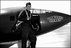 Yeager posing by X-1, with parachute on
