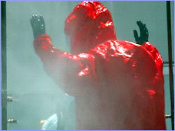 Man being sprayed with decontaminant