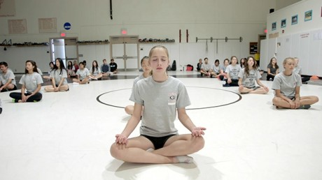 Students meditating at Gunn High School