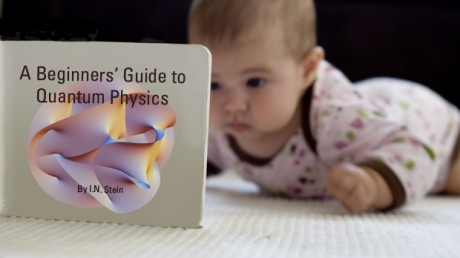 baby reading book twO