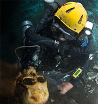 diver recovers ancient skull