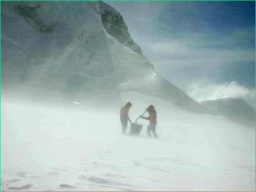 climbers in blowing snow