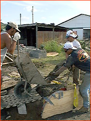 Photo of team pouring concrete into Moai mold
