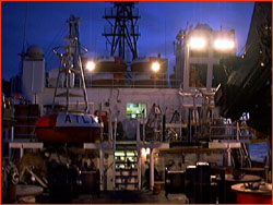 Working on the buoys on the Ka'imi's deck at dusk