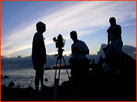 The film crew, silhouetted against the sunset