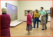 People in an art gallery looking at the artwork