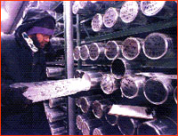 Researcher removing ice core from storage