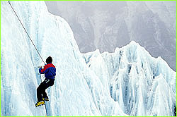 climber rapelling down ice face