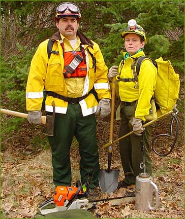 Three firefighers with equipment