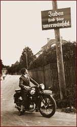 Motorcyclist and sign