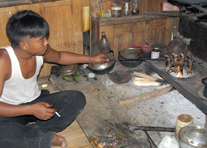 a Mizo villager prepares what he considers a gourmet meal.