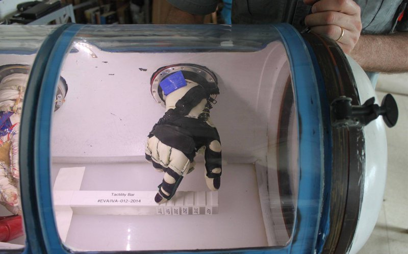Testing astronaut glove inside pressurized capsule