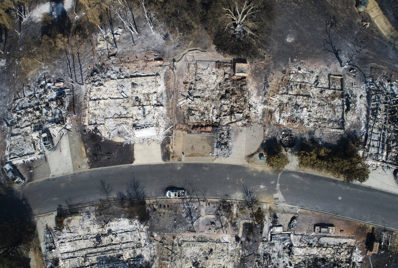 Aerial view of burned houses along a street