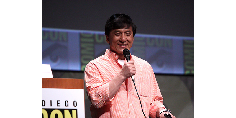 Jackie Chan speaking into a microphone at Comic Con