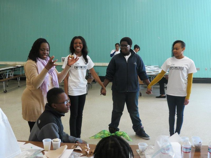 MHP discussing different types of chemical bonds with middle school student participants with the Urban League of Eastern Massachusetts STEM enrichment event (2012 or 2013)..jpeg
