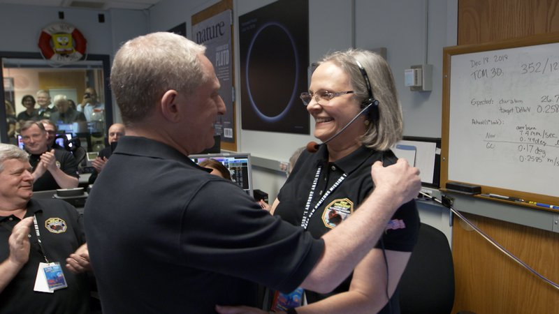 Alan Stern hugs Alice Bowman
