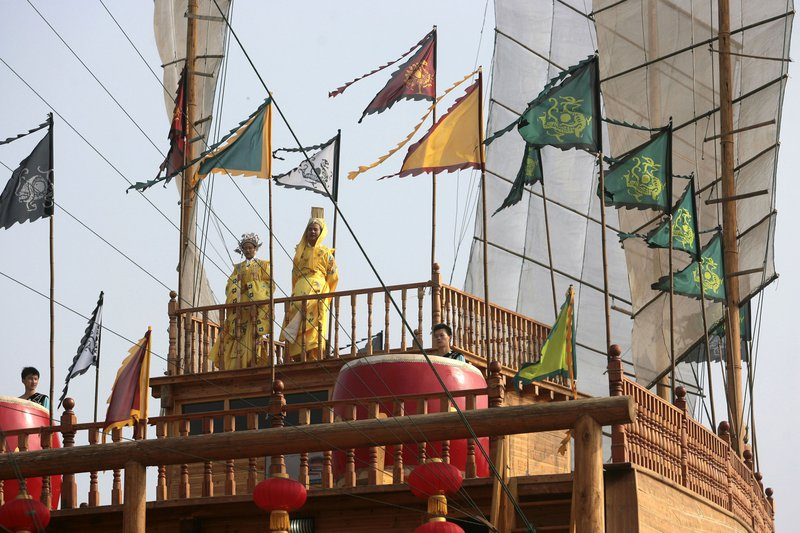 Performers and flags on large ship deck