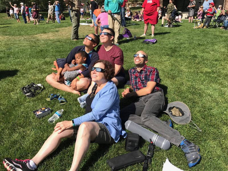 Family watching eclipse