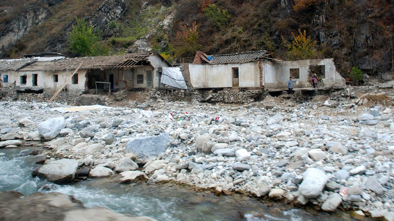 Damage from a flash flood near South Hamgyong, North Korea