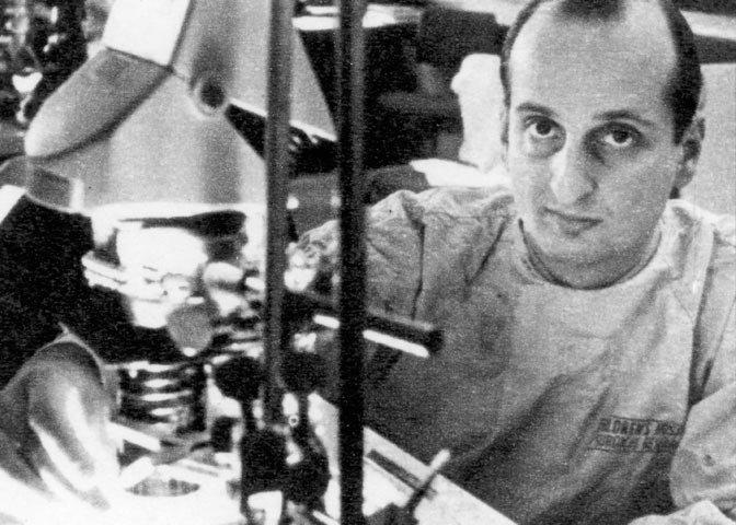 Folkman at microscope