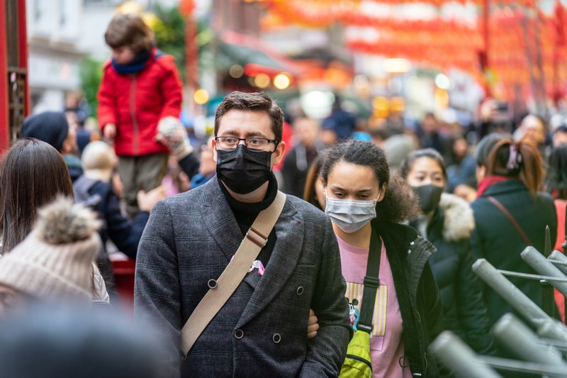 People wearing surgical masks on street
