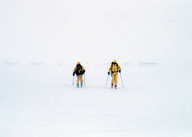 two skiers in yellow