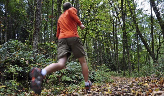 man running forest trail