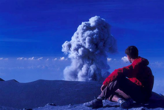 man watching volcano