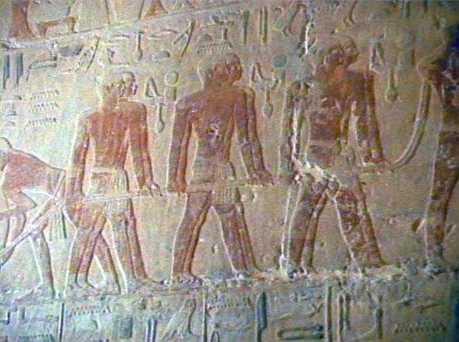 Men pulling stone (relief)