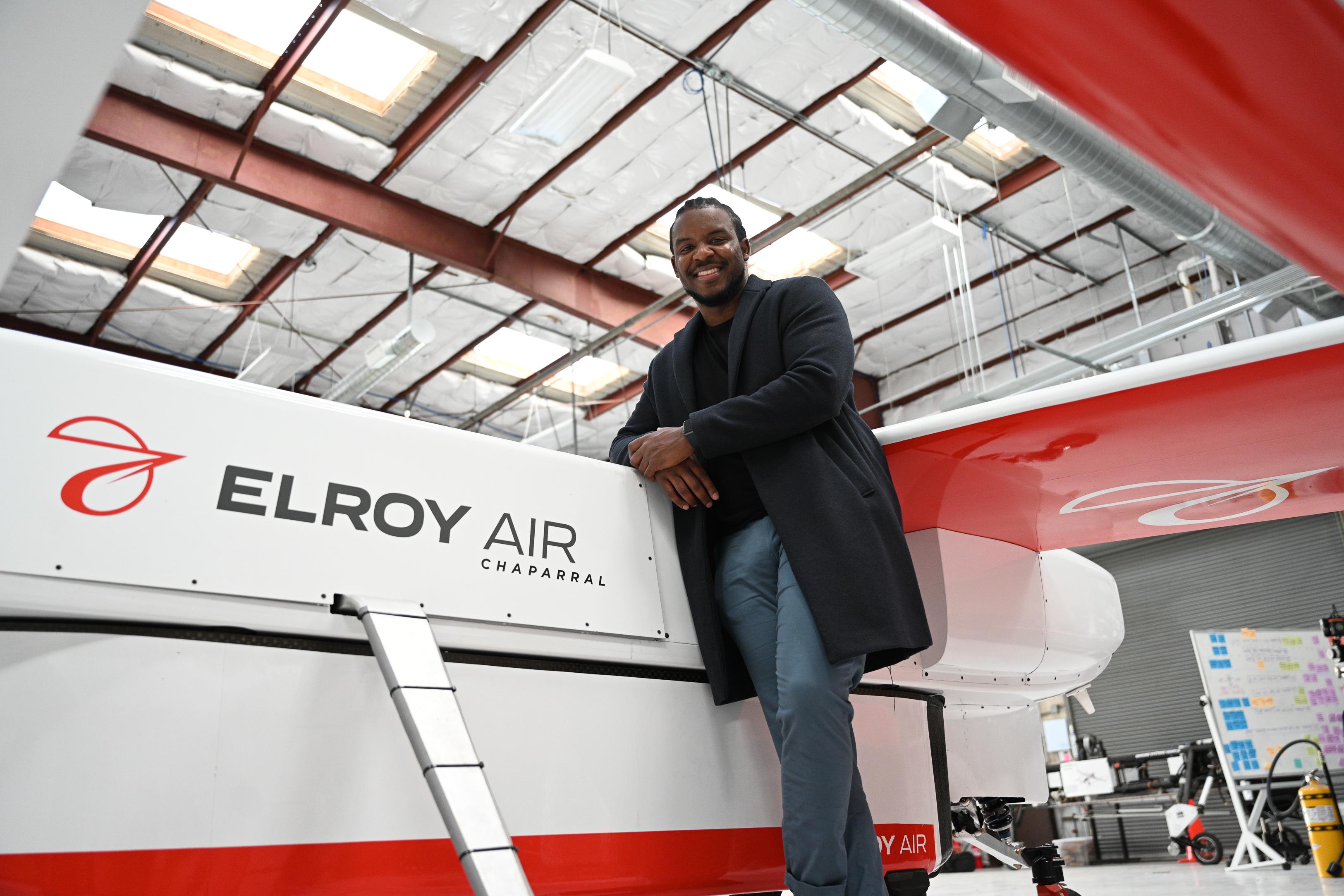 Kofi Asante standing beside the new Chaparral aircraft