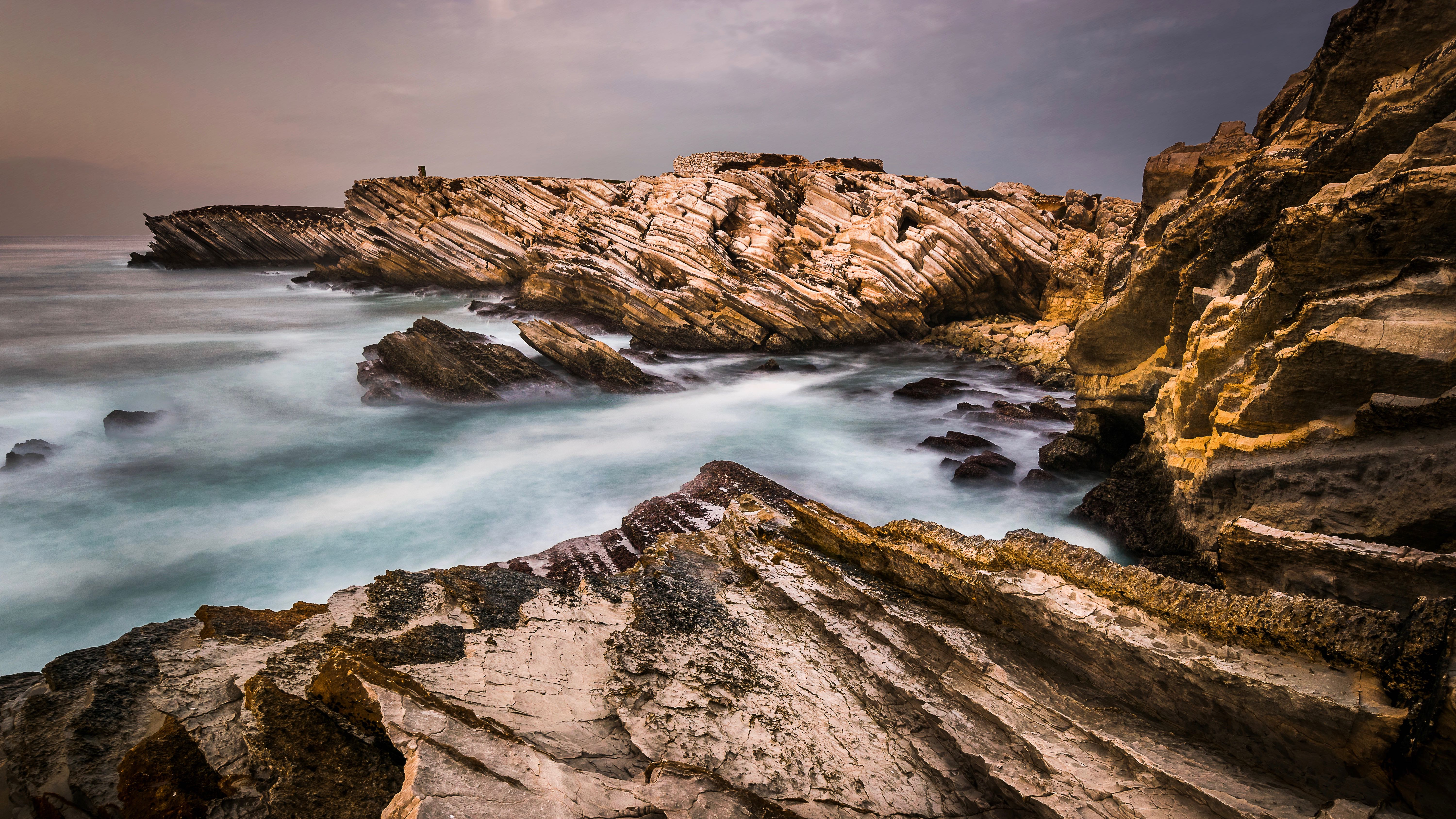 Tilted_Jurassic_Carbonate_Rock_Layers_at_Baleal_in_Portugal