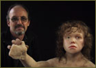 Mark Davis with sculpted Neanderthal boy