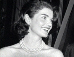 Jacqueline Kennedy, wearing pearls