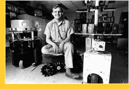 Dr. Hans Moravec in his lab, surrounded by robots