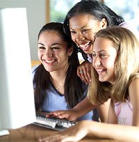 Students gathered around computer