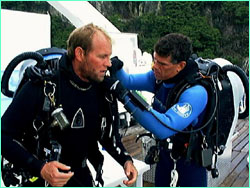 Howard and Bob putting on rebreathers