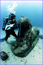 Diver making notes on sphinx